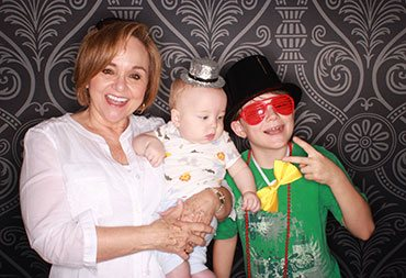 Karen with two youngsters being silly together