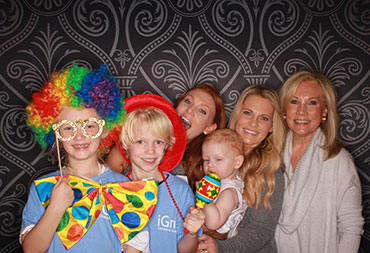 Our staff with their kids goofy off in silly costumes